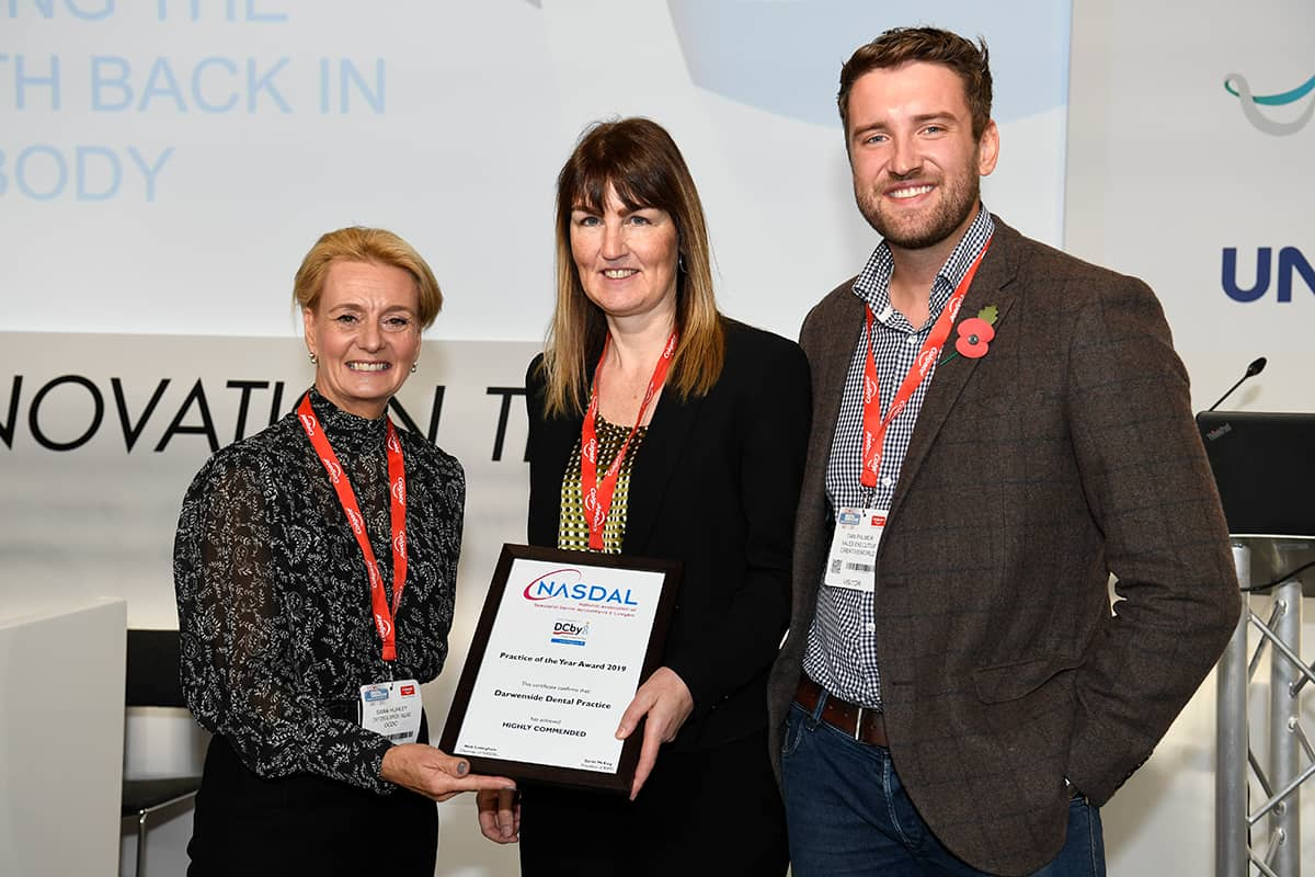 Creativeworld with Darwenside Dental practice, accepting the Highly Commended Award for their work in the Smile4Life initiative